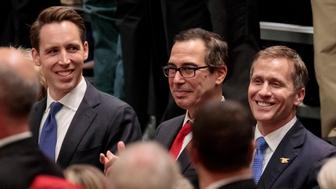ST CHARLES, MO - NOVEMBER 29: Missouri Attorney General and U.S. Senate candidate Josh Hawley (L-R), Treasury Secretary Steven Mnuchin, and Missouri Gov. Eric Greitens listen to U.S. President Donald Trump during a rally at the St. Charles Convention Center on November 29, 2017 in St. Charles, Missouri. Trump promoted the GOP tax reform plan during the speech. (Photo by Whitney Curtis/Getty Images)