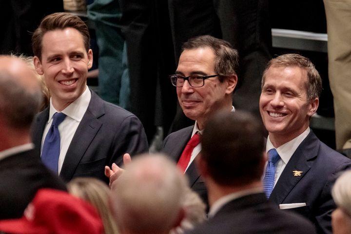 State Attorney General Josh Hawley (left) and Gov. Eric Greitens flank U.S. Treasury Secretary Steven Mnuchin at a Trump rall