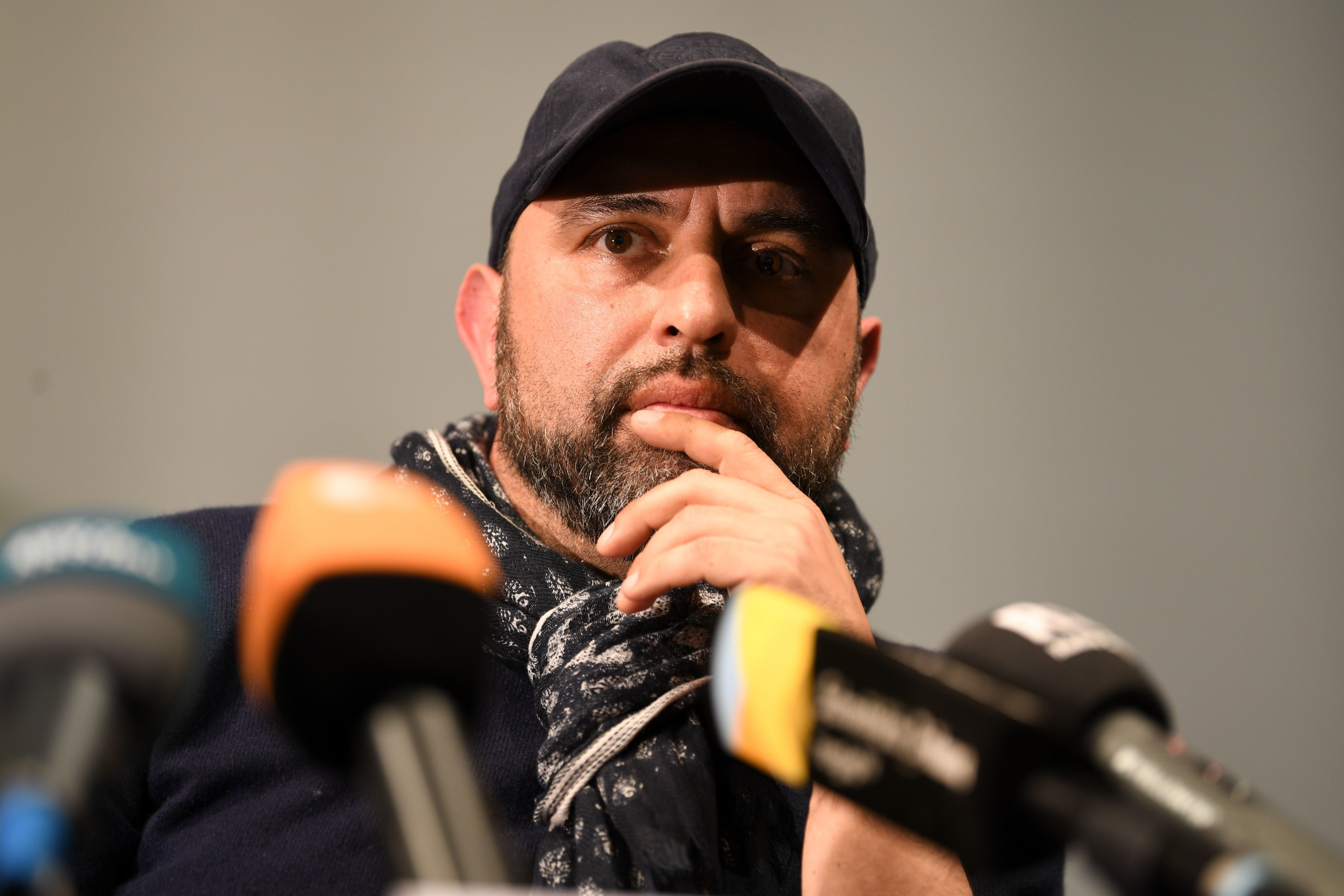 Theatre director Serdar Somuncu speaks during a press conference Wednesday after local prosecutors began looking into th