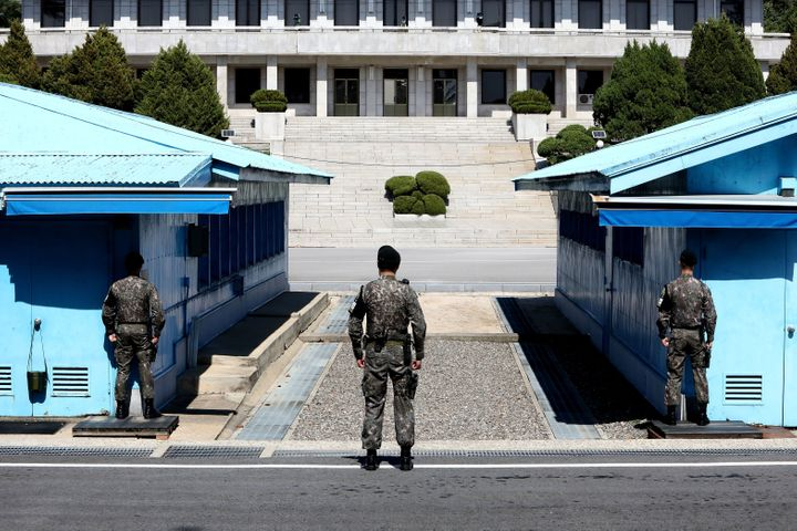 South Korean soldiers stand guard at the Demilitarized Zone on April 11. The Korean War has never been formally ended, a