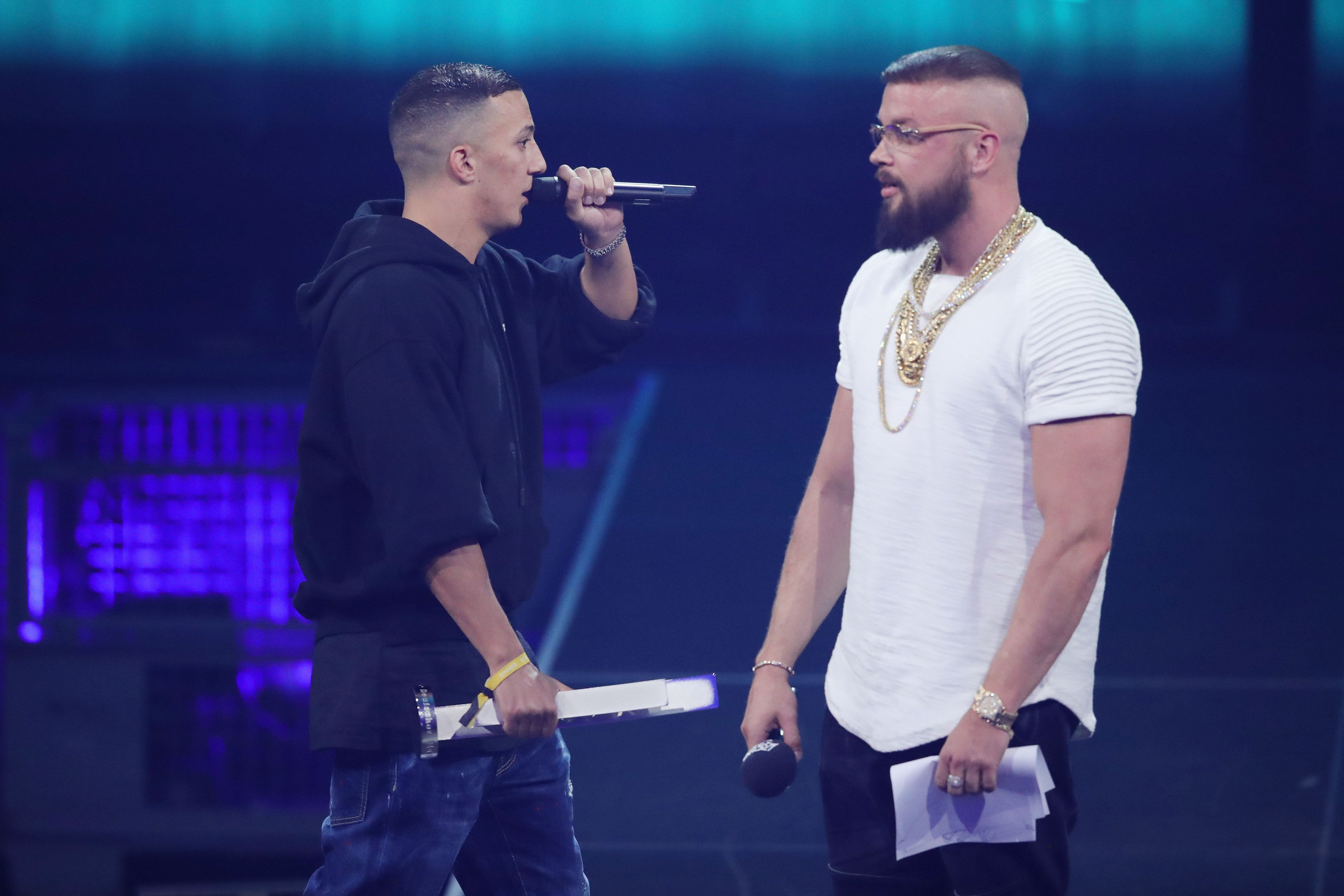 BERLIN, GERMANY - APRIL 12:  'Hip-Hop/Urban - National' award winners Farid Bang and Kollegah speak on stage during the Echo Award show at Messe Berlin on April 12, 2018 in Berlin, Germany.  (Photo by Andreas Rentz/Getty Images)