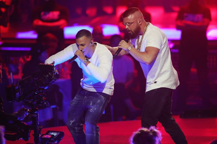 Hip-hop artists Farid Bang and Kollegah perform during the Echo Awards on April 12, 2018. Some of the lyrics on their latest
