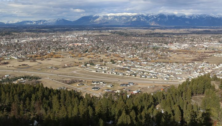 A view of the city of Kalispell, Montana, from the top of Lone Pine State Park. In the distance are the vistas of Glacier Nat