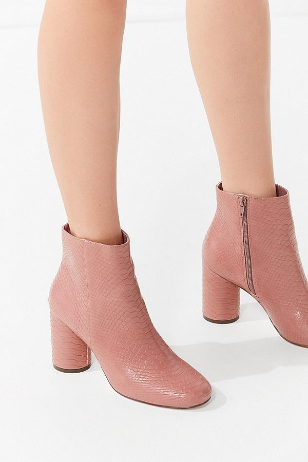 """<a href=""""https://www.urbanoutfitters.com/shop/sabrina-faux-snakeskin-ankle-boot?category=women-shoes-on-sale&color=054"""" t"""