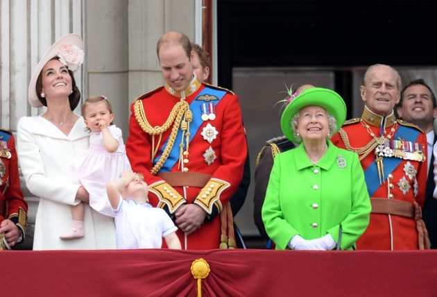 The Queen, Prince Philip and the Duke and Duchess of Cambridge stand on the balcony at Buckingham Palace...