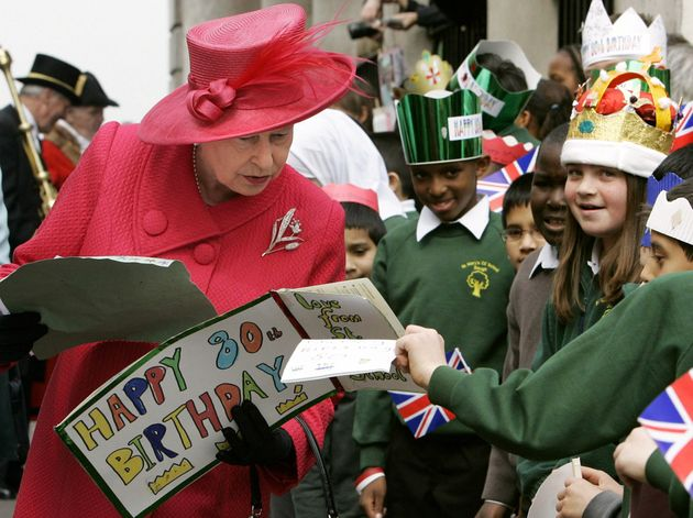 The Queen collects handmade cards from schoolchildren during a walkabout to celebrate her 80th birthday...