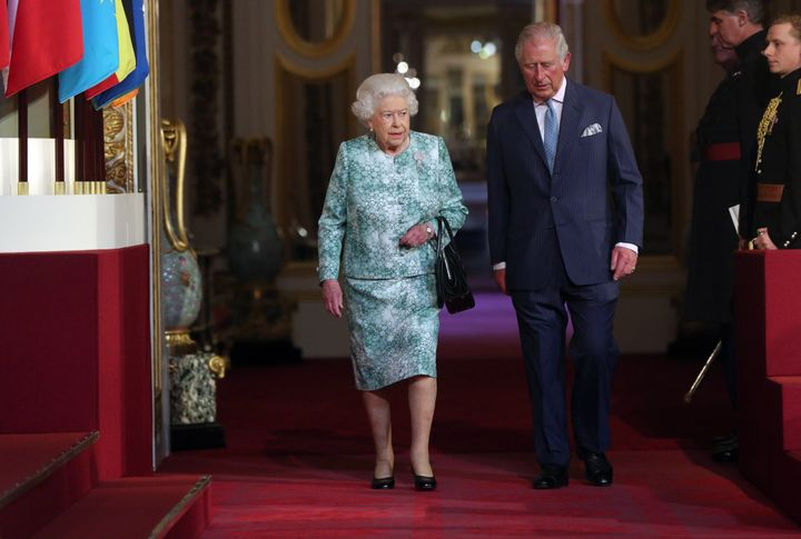 Queen Elizabeth II and Prince Charles attend the formal opening of the Commonwealth Heads of Government Meeting on Thurs