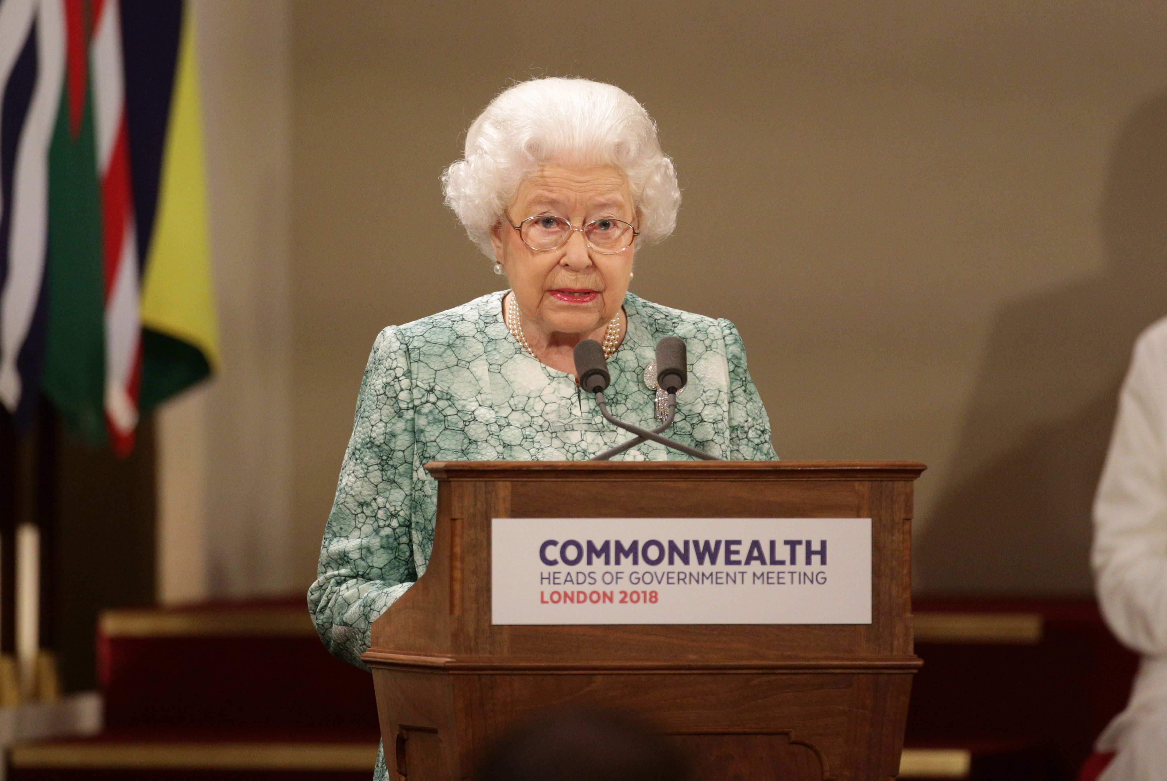 LONDON, ENGLAND - APRIL 19: Queen Elizabeth II gives a speech at the formal opening of the Commonwealth Heads of Government Meeting (CHOGM) in the ballroom at Buckingham Palace on April 19, 2018, in London, England.  (Photo by Yui Mok-WPA Pool/Getty Images)