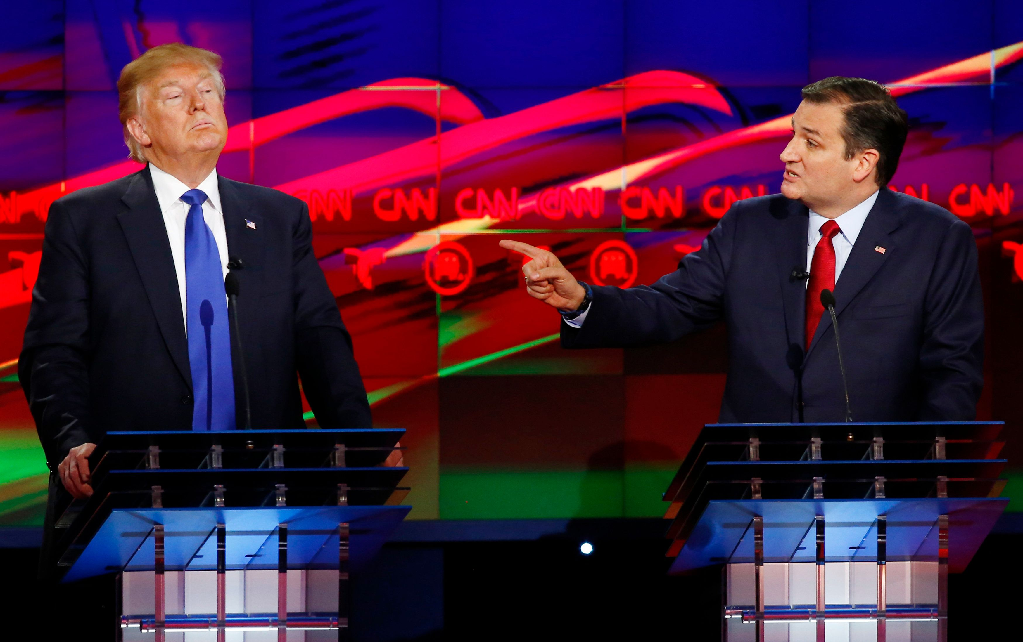 Republican U.S. presidential candidate Ted Cruz challenges rival Donald Trump (L) about releasing his tax returns during the debate sponsored by CNN for the 2016 Republican U.S. presidential candidates in Houston, Texas, February 25, 2016. REUTERS/Mike Stone/File Photo
