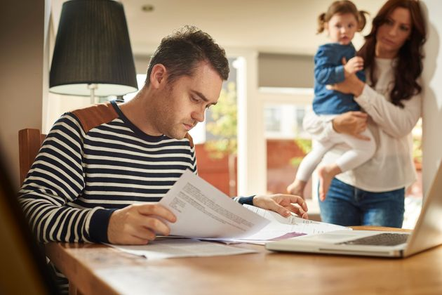 Parents working full-time earning less than £8.75 an hour say they worry about finances, poll finds (stock photo).