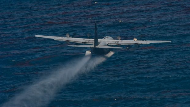 A U.S. Air Force chemical dispersing C-130 aircraft from the 910th Airlift Wing at Youngstown-Warren Air Reserve Station, Ohio, drops an oil dispersing chemical into the Gulf of Mexico as part of the Deepwater Horizon Response effort May 5, 2010. Members of the 910th Airlift Wing are in Mississippi to assist with response to the Deepwater Horizon oil spill. The 910th AW specializes in aerial spray and is the Department of DefenseÕs only large area fixed wing aerial spray unit. | Location: Stennis International Airport, Mississippi, USA. (Photo by Tech. Sgt. Adrian Cadiz/US Air Force/Handout/Corbis via Getty Images)