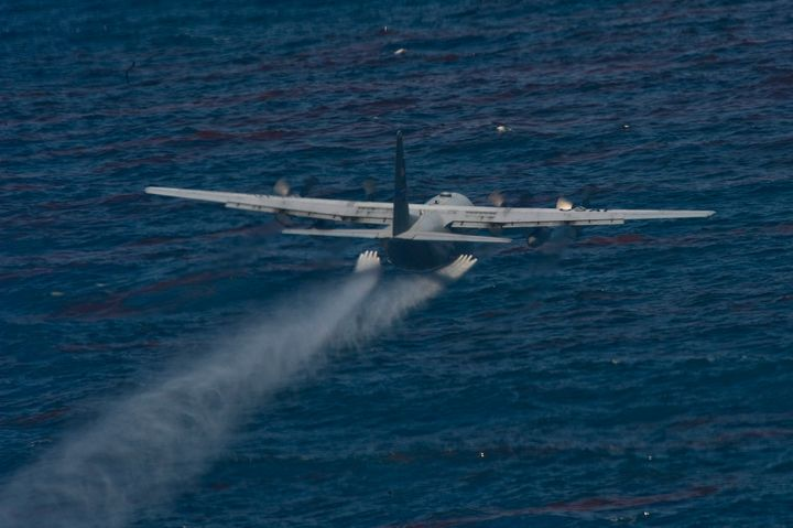 A U.S. Air Force chemical-dispersing C-130 aircraft drops an oil-dispersing chemical into the Gulf of Mexico as part of the D