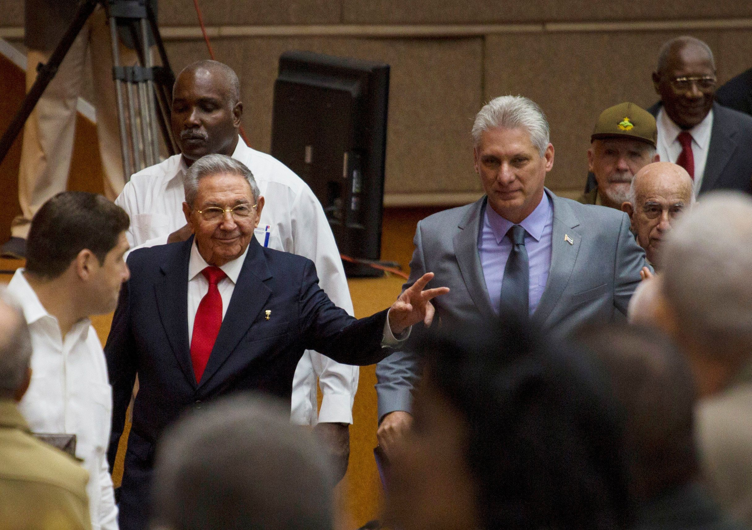 Cuba's President Raul Castro (C-L) and First Vice-President Miguel Diaz-Canel (C-R) arrive for a session of the National Assembly in Havana, Cuba, April 18, 2018.  Irene Perez/Courtesy of Cubadebate/Handout via Reuters. ATTENTION EDITORS - THIS PICTURE WAS PROVIDED BY A THIRD PARTY.
