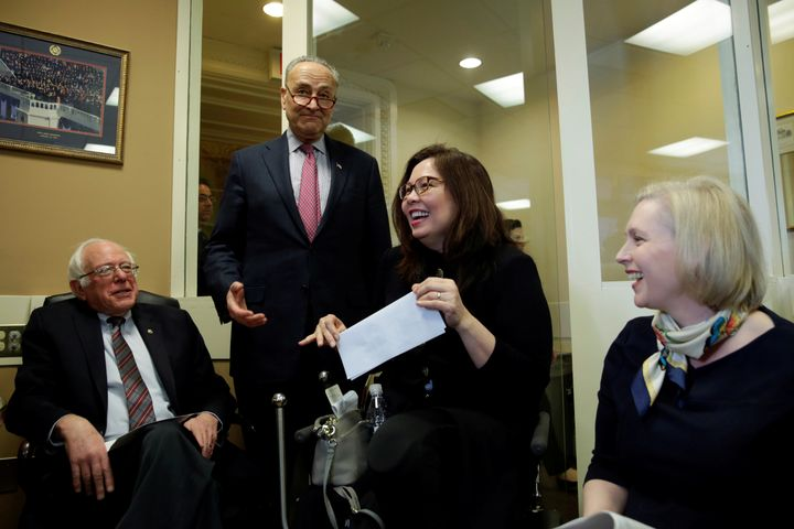 Senators laughing before a March 2017 news conference to introduce (again) the FAMILY Act.