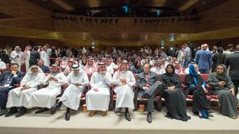 A handout picture provided by the Saudi Royal Palace on April 18, 2018, shows Saudi Information Minister Awwad Alawwad (C) holding a small bucket of popcorn as he attends a test screening at the AMC cinema in the capital Riyadh, the first test in over three decades. Blockbuster action flick 'Black Panther' play at a cinema test screening in Saudi Arabia on April 18, the first in a series of trial runs before movie theatres open to the wider public next month. The conservative kingdom lifted a 35-year ban on cinemas last year as part of a far-reaching liberalisation drive, with US giant AMC Entertainment granted the first licence to operate movie theatres. / AFP PHOTO / Saudi Royal Palace / BANDAR AL-JALOUD / XGTY / RESTRICTED TO EDITORIAL USE - MANDATORY CREDIT 'AFP PHOTO / SAUDI ROYAL PALACE / BANDAR AL-JALOUD' - NO MARKETING - NO ADVERTISING CAMPAIGNS - DISTRIBUTED AS A SERVICE TO CLIENTS        (Photo credit should read BANDAR AL-JALOUD/AFP/Getty Images)