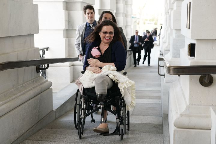 Sen. Tammy Duckworth (D-Ill.) arrives at the U.S. Capitol with her newborn baby daughter Maile Pearl Bowlsbey for a vote on t