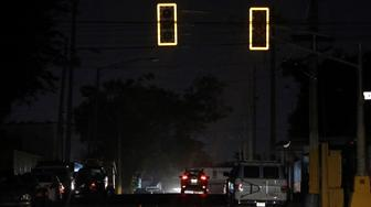 A general view shows a street with traffic lights gone out after Puerto Rico Electric Power Authority (PREPA), the island's power company, said on Wednesday that a major power line failure in southern Puerto Rico cut electricity to almost all customers, in San Juan, Puerto Rico April 18, 2018. REUTERS/Gabriel Lopez Albarran