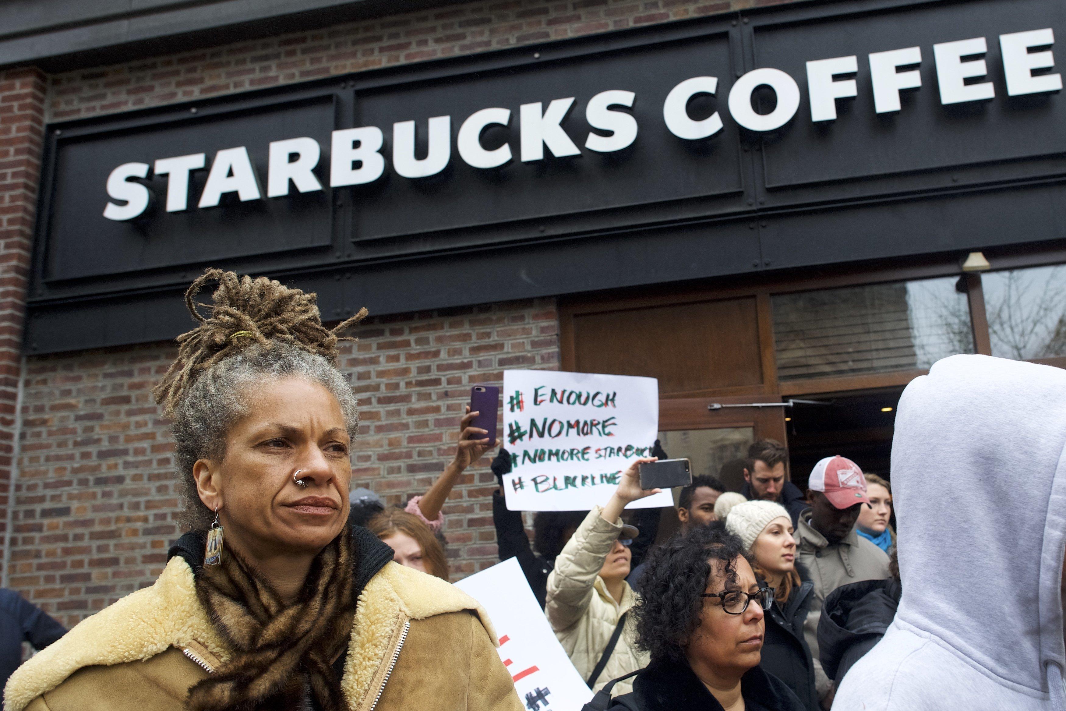 Protester Michelle Brown outside a Center City Starbucks on Sunday in Philadelphia.