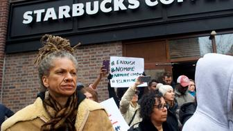 PHILADELPHIA, PA - APRIL 15:  Protestor Michelle Brown, 50, (L) demonstrates outside a Center City Starbucks on April 15, 2018 in Philadelphia, Pennsylvania. Police arrested two black men who were waiting inside the Center City Starbucks which prompted an apology from the company's CEO.  (Photo by Mark Makela/Getty Images)