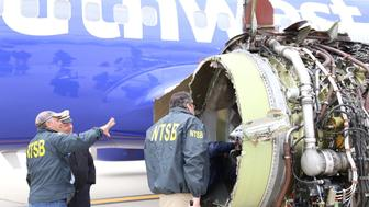 U.S. NTSB investigators are on scene examining damage to the engine of the Southwest Airlines plane in this image released from Philadelphia, Pennsylvania, U.S., April 17, 2018.    NTSB/Handout via REUTERS  ATTENTION EDITORS - THIS IMAGE HAS BEEN SUPPLIED BY A THIRD PARTY.
