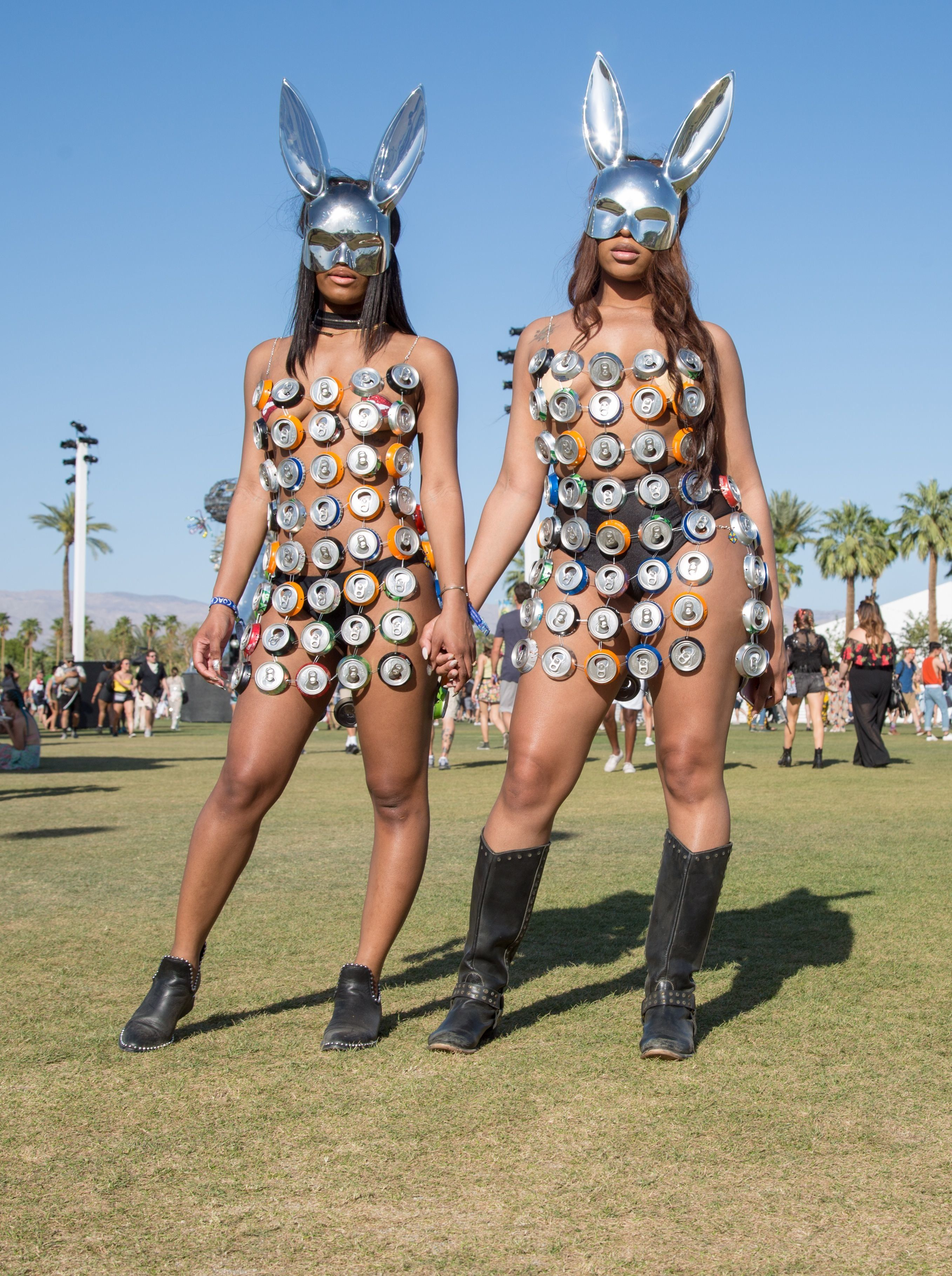 Chanel Twyman (L), 23, and Auzuanay Watkins, 25, both of Philadelphia, Pennsylvania pose at the Coachella Music and Arts Festival in Indio, California, April 14, 2018. Coachella became one of the world's premier music festivals not only for the A-list performers. The two-weekend party in the California desert has become a major event in its own right for the fashion. While designers have heavily marketed their brands to Coachella, the fans who draw the most notice often do so by embracing their own sartorial flair, driven by a sense of innovation and, among revelers in the searing heat, of inhibition.  / AFP PHOTO / Kyle Grillot / TO GO WITH AFP STORY by Shaun TANDON, 'From flowers to bondage, a fashion bonanza at Coachella'        (Photo credit should read KYLE GRILLOT/AFP/Getty Images)