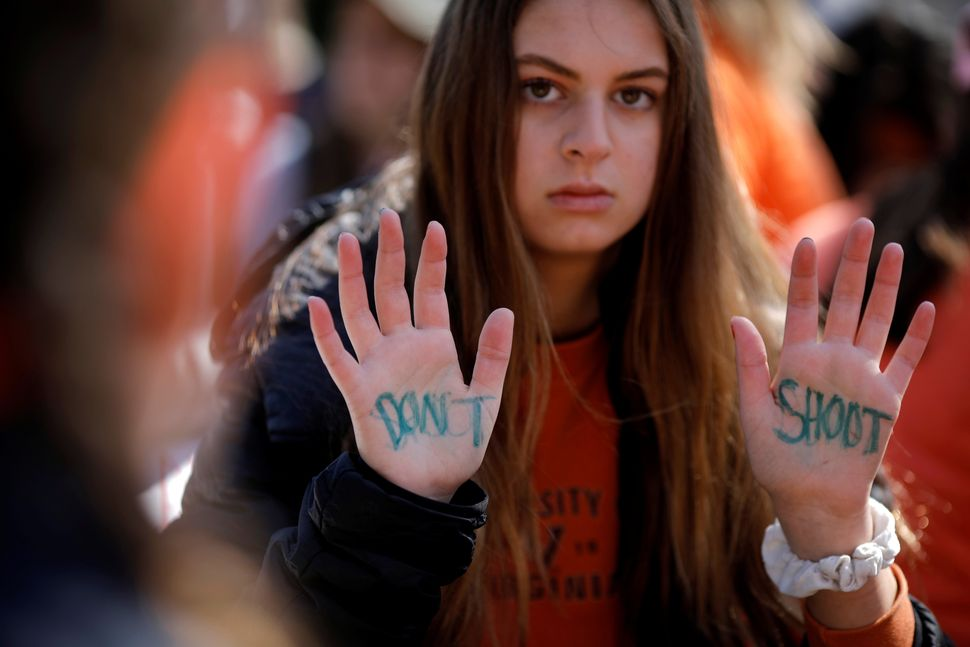 A student attends a rally outside the White House.