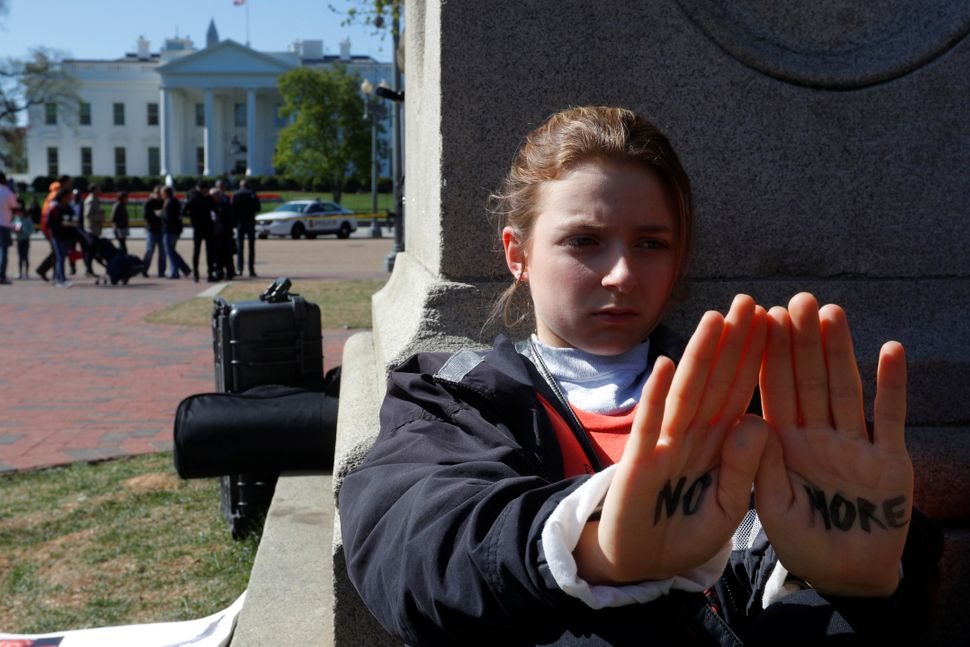 Emma Corcoran joins students observing 19 minutes of silence outside the White House.