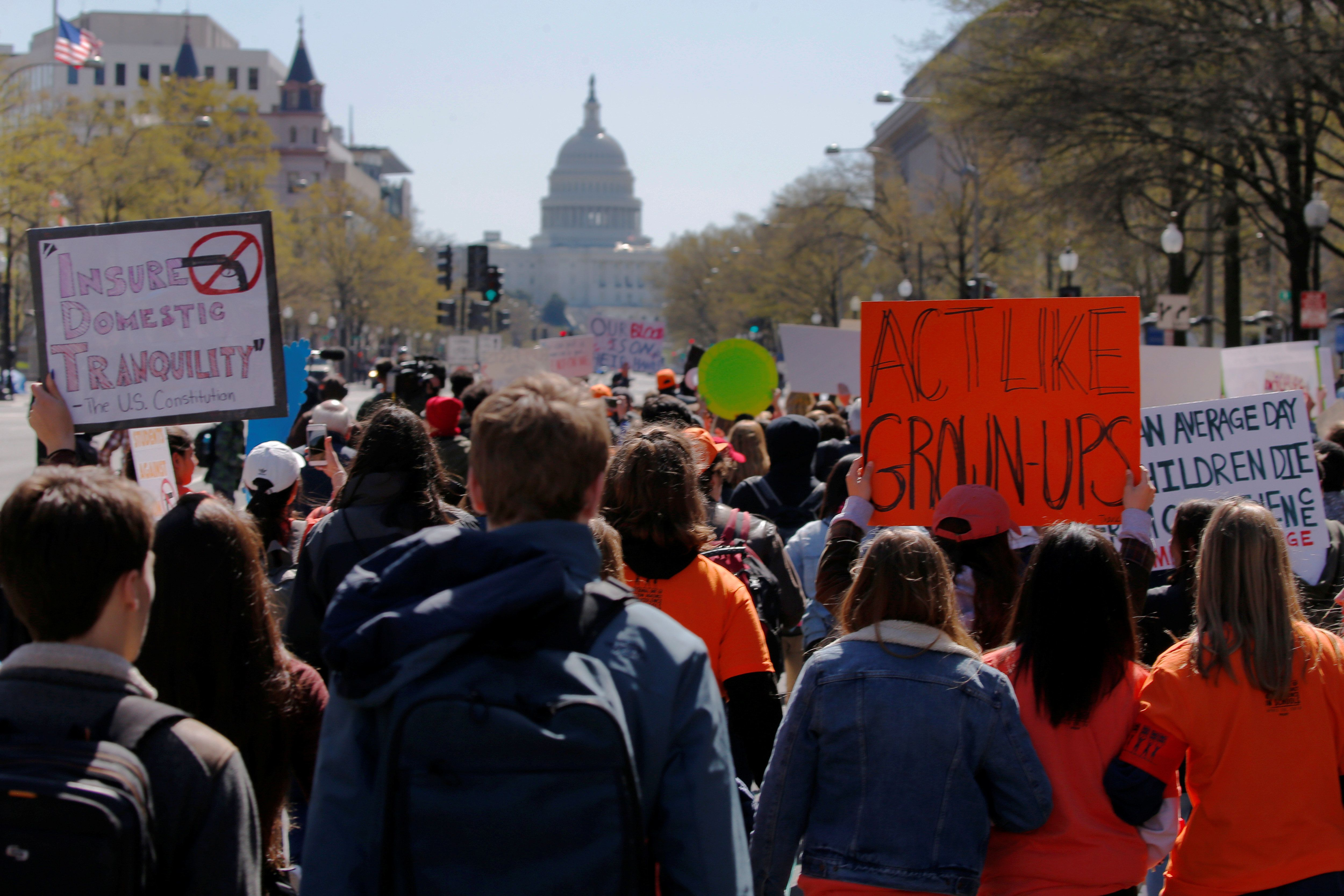 Students march to the U.S. Capitol, as part of a nationwide walk-out of classes to mark the 19th anniversary of the Columbine High School mass shooting, in Washington, DC, U.S., April 20, 2018.   REUTERS/Brian Snyder