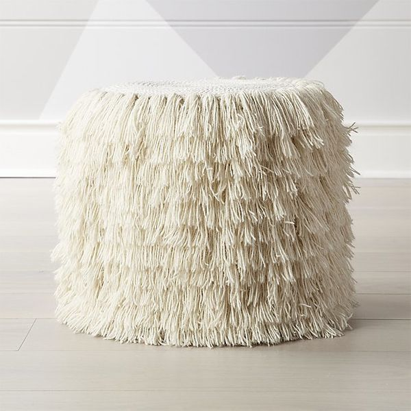 """Get it from <a href=""""https://www.crateandbarrel.com/white-shag-pouf/s515894"""" target=""""_blank"""">Crate and Barrel</a>."""