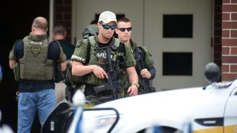 OCALA, FL - APRIL 20:  Marion County Sheriffs officers walk out Forest High School after a school shooting on April 20, 2018 in Ocala, Florida.  It was reported that a former student shot a 17-year-old male student in the ankle The shooter, whose name has not yet been released, is in custody.  (Photo by Gerardo Mora/Getty Images)