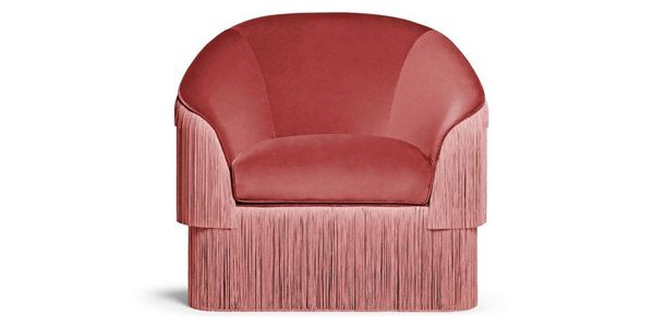 """Get it from <a href=""""https://www.thelongeststay.com/munna-fringes-armchair"""" target=""""_blank"""">The Longest Stay</a>."""