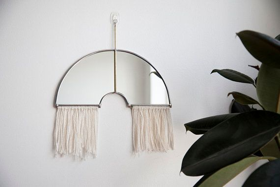 """Get it from <a href=""""https://www.etsy.com/listing/603734531/rainbow-mirror-with-fringe-and-brass"""" target=""""_blank"""">Etsy</a>.&n"""
