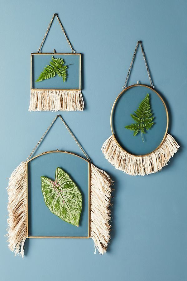"""Get it from <a href=""""https://www.anthropologie.com/shop/fringed-hanging-frame?category=SEARCHRESULTS&color=010"""" target=""""_"""