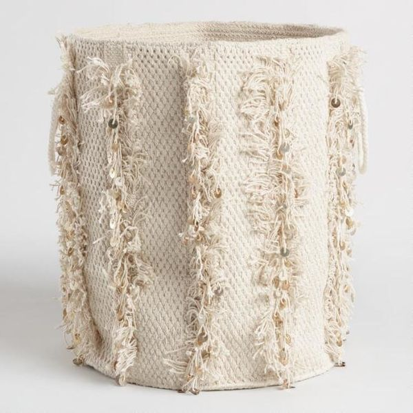 """Get it from <a href=""""https://www.worldmarket.com/product/fringed-fabric-nadia-tote-basket.do?sortby=ourPicks&from=Search"""""""