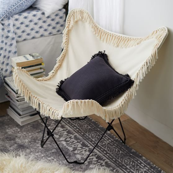 """Get it from <a href=""""https://www.pbteen.com/products/ivory-canvas-fringe-butterfly-chair/"""" target=""""_blank"""">PBTeen</a>."""