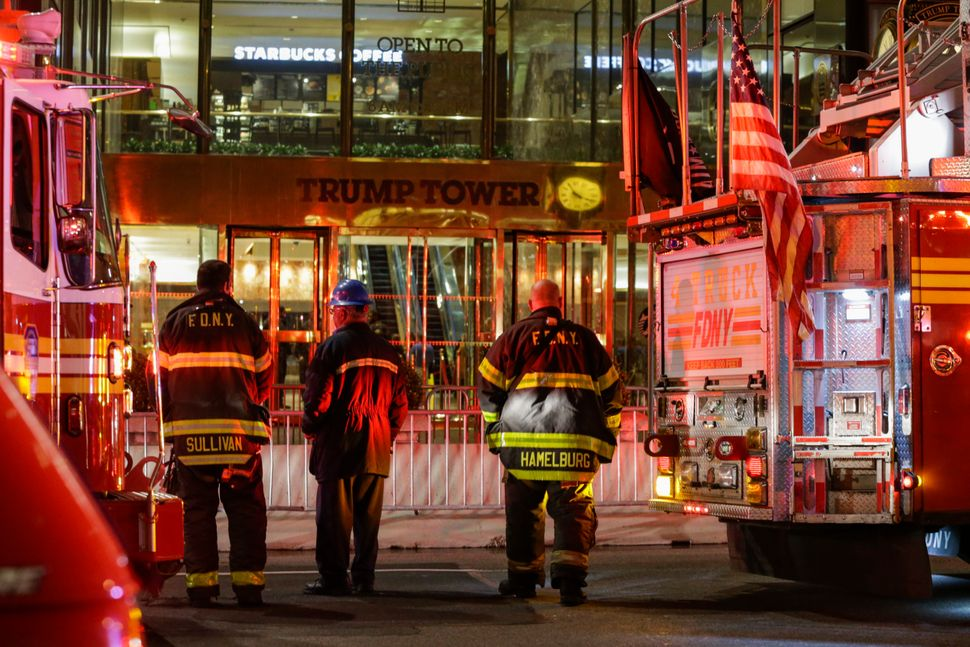 Firefighters at Trump Tower on April 7 in Manhattan. Six firefighters were injured battling the blaze that broke out on