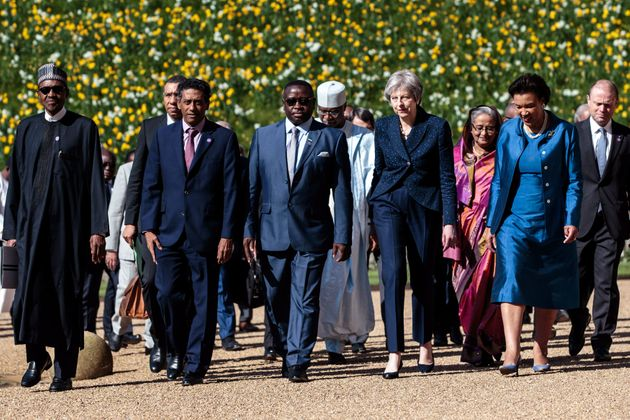 Prime Minister Theresa May walks with commonwealth leaders at Windsor Castle during the Commonwealth Heads of Government Meeting on Friday.