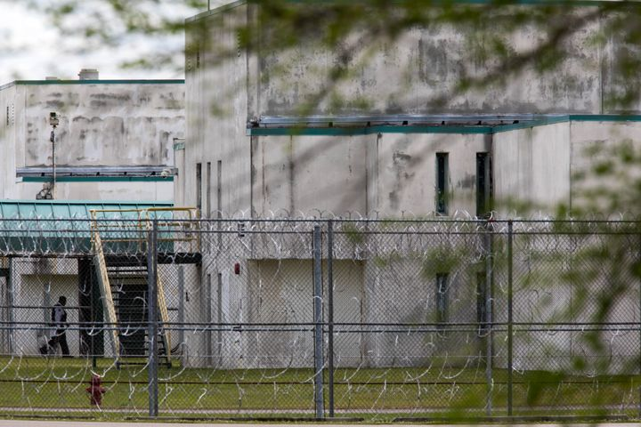 A guard walks between buildings at the Lee Correctional Institution, in Bishopville, South Carolina, on April 16, 2018.