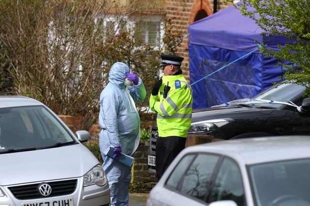 A police officer and a forensic officer outside the house of Richard Osborn-Brooks in South Park Crescent in Hither Green, south east London (file photo).