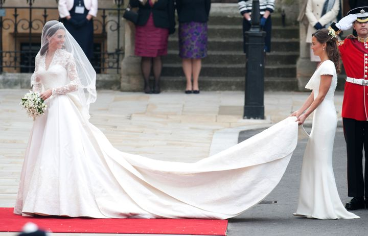 Kate Middleton arrives at Westminster Abbey on her wedding day, April 29, 2011, wearing the now-famous long-sleeved Sarah Burton for Alexander McQueen gown.