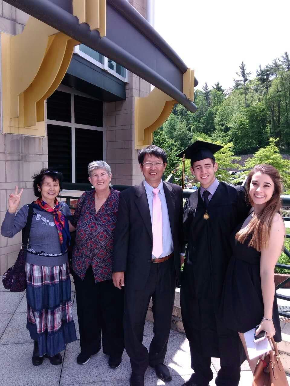 Rev. John Sanqiang Cao (center) poses in a picture with his family. The pastor is currently imprisoned in China.