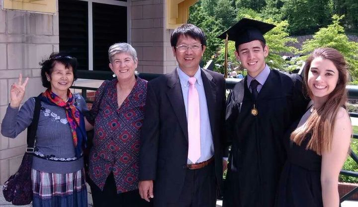 Rev. John Sanqiang Cao (center) poses in a picture with his family. The elder Cao has Chinese citizenship and U.S. residency,