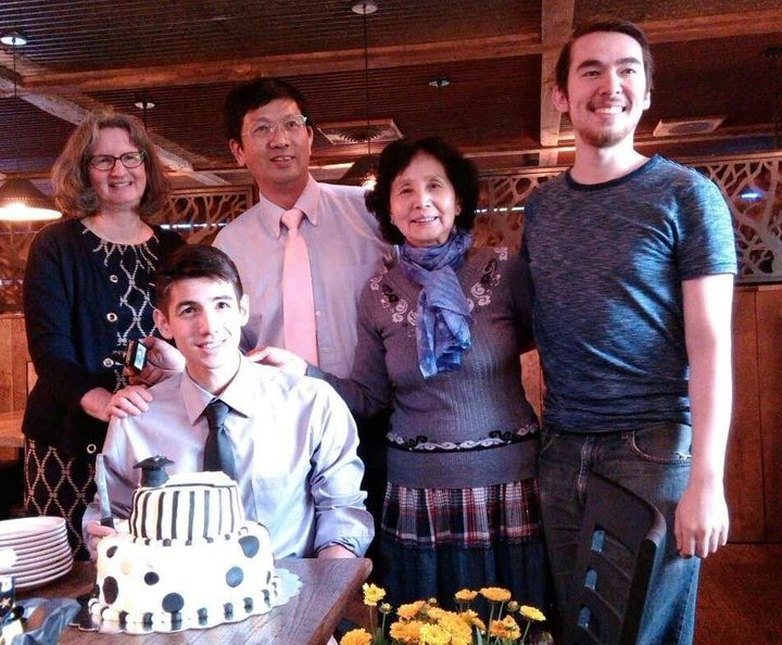 Rev. Cao poses with family members.