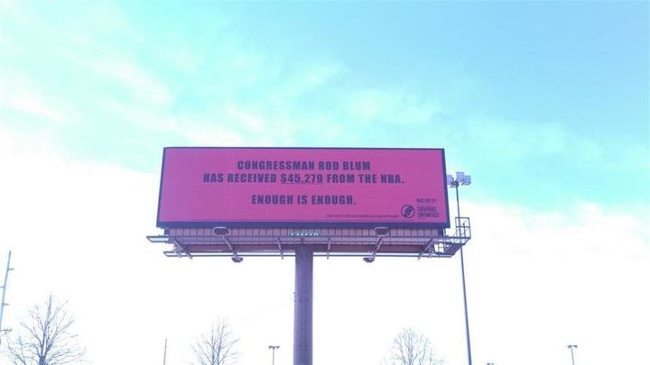 A billboard in Cedar Rapids, Iowa, calls out Rep. Rod Blum (R-Iowa).