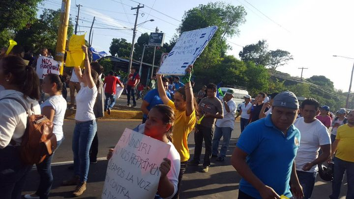 Demonstrators chant against social security cuts in Masaya, in western Nicaragua.