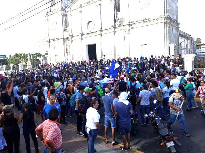 Protesters outside a cathedral in Managua.