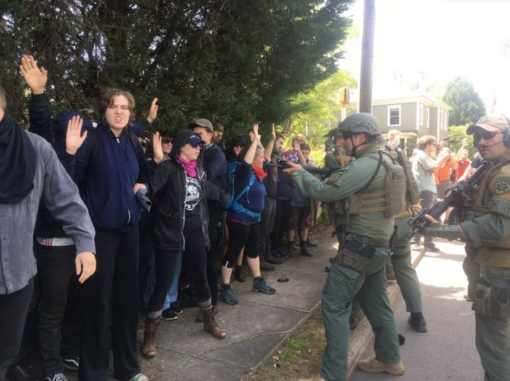 Police officers corner a group of counterprotesters at a neo-Nazi rally in Georgia on Saturday.