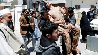 ATTENTION EDITORS - VISUAL COVERAGE OF SCENES OF INJURY OR DEATH Relatives of the victims carry an injured man outside a hospital after a suicide attack in Kabul, Afghanistan April 22, 2018.REUTERS/Mohammad Ismail TEMPLATE OUT