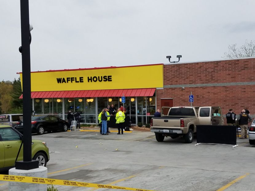 Authorities were searching for a gunman who fatally shot several people at this Waffle House in Tennessee early Sunday