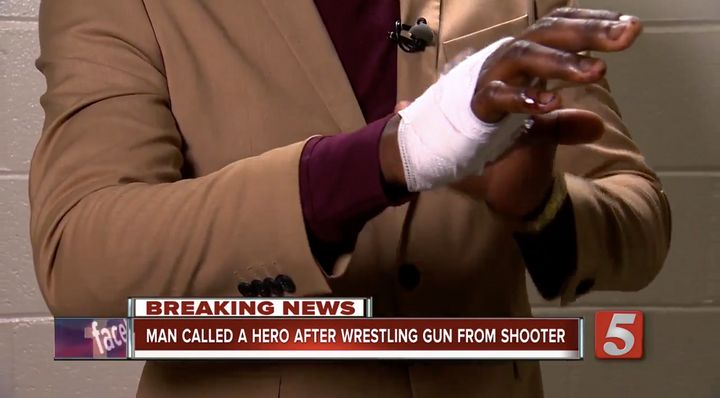 James Shaw, Jr. shows off his bandaged hand after disarming a gunman early Sunday morning.